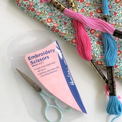 Hemline blue polka dot scissors